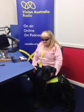 Vicki Couzens with her dog guide Bella in the VAR Adelaide studios